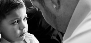 Young-boy-being-scolded-by-his-father-by-Servando-Miramontes-702x336