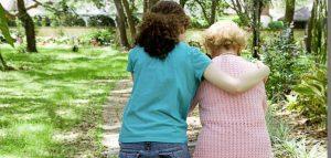 Helping-elderly-grandma-walk-702x336