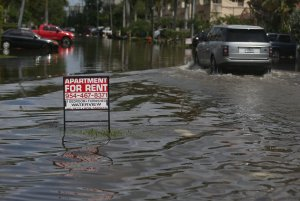 FORT LAUDERDALE, FL - SEPTEMBER 30: An apartment for rent sign is seen in a flooded street caused by the combination of the lunar orbit which caused seasonal high tides and what many believe is the rising sea levels due to climate change on September 30, 2015 in Fort Lauderdale, Florida. South Florida is projected to continue to feel the effects of climate change and many of the cities have begun programs such as installing pumps or building up sea walls to try and combat the rising oceans. (Photo by Joe Raedle/Getty Images)