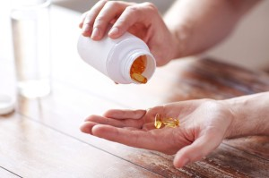 taking-supplements-from-bottle-660x440